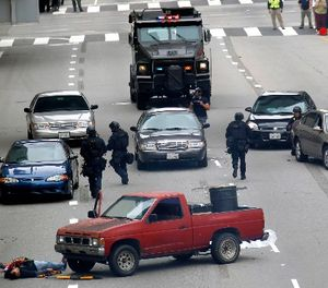 In this June 6, 2013 file photo, Los Angeles police take part in a downtown counterterrorism drill. (AP Photo/Nick Ut, File)
