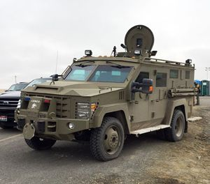 An armored vehicle known as a Bearcat blocks the road to the Malheur Wildlife Refuge at an FBI checkpoint outside of Burns, Ore., Friday, Feb. 12, 2016. (AP Photo/Rebecca Boone)