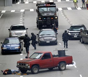 In this June 6, 2013 file photo, Los Angeles police take part in a downtown counterterrorism drill. (AP Image)