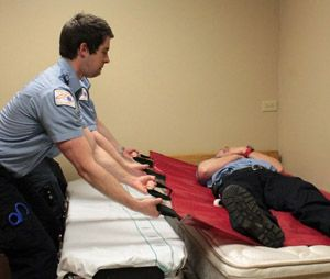Patient moving technique using a flexible stretcher. (Image Bryan Fass)