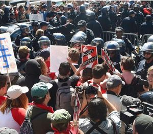 Protesters confront San Francisco Police officers outside of Alamo Square Park in San Francisco, Saturday, Aug. 26, 2017. Officials took steps to prevent violence ahead of a planned news conference by a right-wing group. (AP Photo/Marcio Jose Sanchez)
