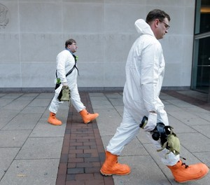Firefighters in protective clothing prepare to enter the U.S. Courthouse in Philadelphia Wednesday, Feb. 20, 2013. The second floor of the federal court building was evacuated after authorities found a letter containing a threat about anthrax. (AP Photo/Matt Rourke)