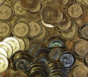 This April 3, 2013 photo shows bitcoin tokens at 35-year-old software engineer Mike Caldwell's shop in Sandy, Utah. (AP Photo/Rick Bowmer)