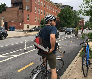 A bicyclist uses a Baltimore bike lane. (Photo/Bikemore)