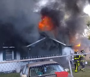 Capt. Schwarz can be seen in a video fighting a house fire while off duty. (Photo/YouTube)
