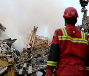 Firefighters work to remove debris of the Plasco building. (AP Photo/Vahid Salemi)