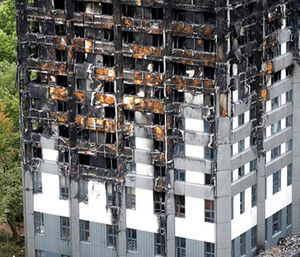 The burnt Grenfell Tower apartment building standing testament to the recent fire in London. (AP Photo/Frank Augstein)
