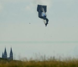 A blimp crashes during the first round of the U.S. Open golf tournament. (AP Photo/Charlie Riedel)