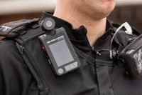 Should police view body worn cameras before writing a report?