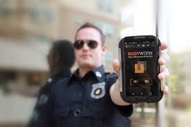 Police officer holding a body camera (Photo/Pixabay)