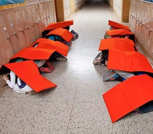 Students demonstrate how the Bodyguard blanket works. (Photo courtesy Bodyguard Facebook)