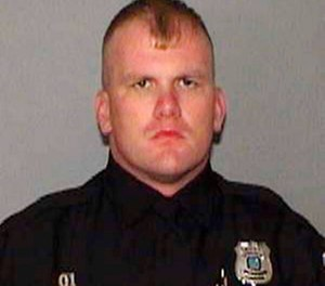This undated file photo provided by the Memphis Police Department shows Officer Sean Bolton, who was fatally shot during a traffic stop, Saturday, Aug. 1, 2015, in Memphis, Tenn. News outlets report a jury in state court convicted Tremaine Wilbourn on Sunday, Nov. 4, 2018, in Bolton's fatal shooting. Wilbourn also was found guilty of carjacking and weapons charges. (Memphis Police Department via AP, File)