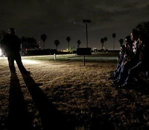 In this June 25, 2014, file photo, a group of immigrants from Honduras and El Salvador, who crossed the U.S.-Mexico border illegally, are stopped in Granjeno, Texas. (AP Image)