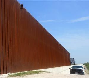 This photo made, Saturday, March 15, 2014 shows a border patrol vehicle patrolling along the Abram border fence in Abram, Texas. (AP Image)