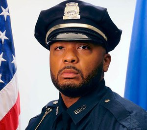 This undated official portrait released by the Boston Police Department shows policer officer Dennis Simmonds, who died on April 10, 2014. (Boston Police Department via AP)