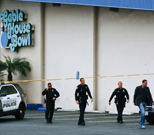 Torrance Police Department investigators walk towards waiting family members, as officers confirm fatalities in a shooting incident at the Gable House Bowl in Torrance, Calif., Saturday, Jan. 5, 2019. A brawl between two large groups at the popular Los Angeles-area bowling alley and karaoke bar erupted into gunfire early Saturday according to witnesses. (AP Photo/Damian Dovarganes)