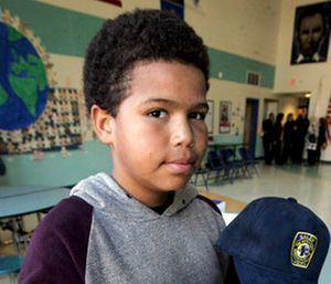 Jaydon Dancy poses for a photo after he was honored by the mayor, police, and other dignitaries in a school-wide assembly for trying to save a man from drowning over the summer in Salem, Mass. (Ken Yuszkus/The Salem News via AP)