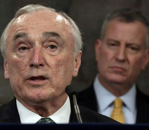 In this Jan. 12, 2016 file photo, New York City Police Commissioner William Bratton, left, speaks during a news conference in New York's City Hall, as New York Mayor Bill de Blasio listens. (AP Photo/Richard Drew, File)