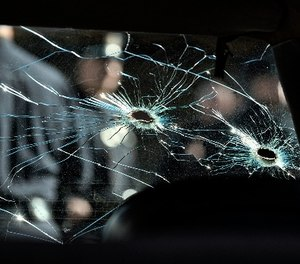 An inside view of a bullet ridden LAPD patrol car windshield is seen while on display at the North Hollywood police station prior to a ceremony marking the 20th anniversary of the shootout. (AP Photo/Richard Vogel)