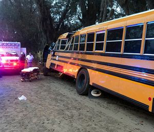 Authorities investigate the scene where a school bus crashed. (AP Photo/Lewis Levine)