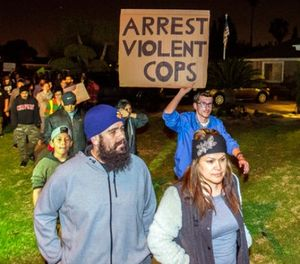 In this Feb. 22, 2017 file photo, protesters march towards a police officer's home, who pulled out a gun and fired a warning shot during an off-duty scuffle with a teenager, in Anaheim, Calif. (Joshua Sudock /The Orange County Register via AP, File)