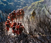 Officials lift most Calif. wildfire evacuations