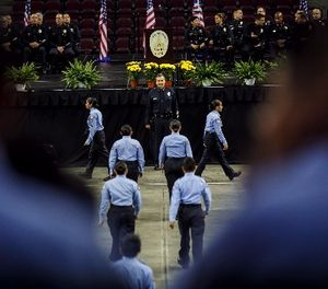 Los Angeles Police Department Chief Charlie Beck inspects the cadets before their graduation at the USC Galen Center in Los Angeles on Saturday, June 24, 2017. (Marcus Yam/Los Angeles Times/TNS)