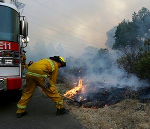 Santa Rosa firefighters work on a fire on the side of a road near the Oakmont area in Santa Rosa, Calif. (AP Photo/Jeff Chiu)
