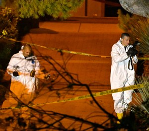 "A forensics team works the scene Thursday, Nov. 8, 2018, in Thousand Oaks, Calif. where a gunman opened fire Wednesday inside a country dance bar crowded with hundreds of people on ""college night,"" wounding 11 people including a deputy who rushed to the scene. (AP Photo/Mark J. Terrill)"
