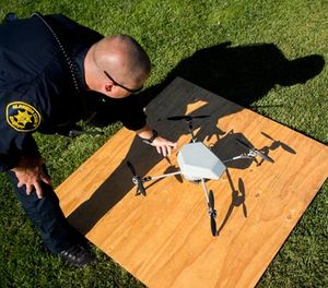 In an Aug. 14, 2015 file photo, Alameda County Sheriff's Deputy Dave Durbin prepares to fly a drone during a demonstration of a search and rescue operation, in Dublin, Calif. (AP Photo/Noah Berger, File)