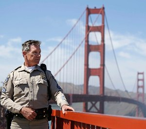 In this Tuesday, April 30, 2013, file photo, California Highway Patrol Sergeant Kevin Briggs poses by the Golden Gate Bridge in San Francisco. (AP Photo/Eric Risberg, File)