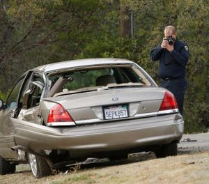 A California Highway patrol officer photographs a vehicle involved in a deadly shooting rampage at the Rancho Tehama Reserve, near Corning, Calif., Tuesday, Nov. 14, 2017. (AP Photo/Rich Pedroncelli)