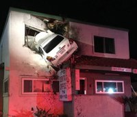 Video: Car goes airborne, crashes into 2nd floor of building