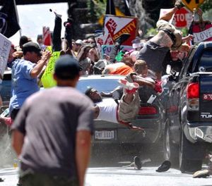 In this Saturday, Aug. 12, 2017 file photo, people fly into the air as a vehicle drives into a group of protesters demonstrating against a white nationalist rally in Charlottesville, Va. (Ryan M. Kelly/The Daily Progress via AP, File)