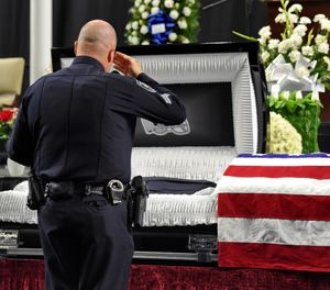 Mourners and police officers from around the country attend a memorial service before the funeral for fallen Florence police officer Sgt. Terrence Carraway Monday, Oct. 8, 2018, at the Florence Center in Florence, S.C. Sgt. Carraway was killed in the line of duty Wednesday, Oct. 3, 2018. (AP Photo/Richard Shiro)