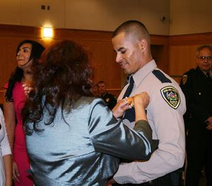 In this Oct. 31, 2013, photo released by Dona Ana County Sheriff shows officer Jose Chavez at his graduation ceremony from our Law Enforcement Academy in Las Cruces, N.M. (Dona Ana County Sheriff via AP)