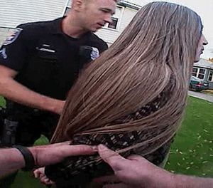 In this image from video provided by the Spokane Police Department police body camera video, police officers arrest a mentally ill woman in October 2014. (Photo/Spokane Police Department via AP)
