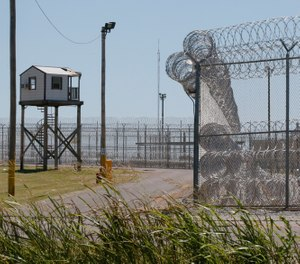 A tower is pictured outside of the razor wire at the Great Plains Correctional Facility in Hinton, Okla. (AP Photo/Sue Ogrocki)