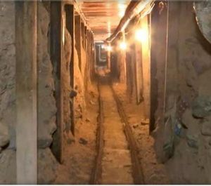 In this frame grab taken from a Monday, Dec. 12, 2016 video provided by the Mexican Attorney General's Office, or PGR, shows one of two tunnels found in an area of warehouses in the border city of Tijuana that lead into California. (Mexico's Attorney General's Office via AP)
