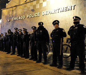 In this Nov. 24, 2015, file photo, Chicago police officers line up outside the District 1 central headquarters in Chicago. (AP Photo/Paul Beaty File)