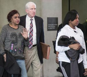 Family members of Brittany Covington and Tanishia Covington, left and right, leave the Leighton Criminal Court Building Friday, Dec. 6, 2016 in Chicago. (Ashlee Rezin/Sun Times via AP)