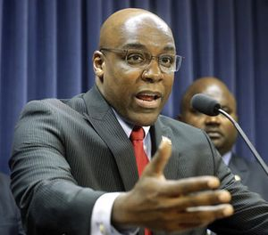In this Aug. 12, 2015 file photo, State Sen. Kwame Raoul, D-Chicago, speaks during a news conference at the Illinois State Capitol, in Springfield, Ill. (AP Photo/Seth Perlman, File)