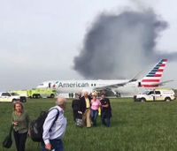 Plane catches fire at Chicago airport; 8 hurt