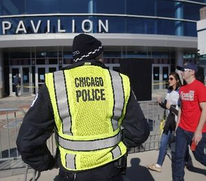 A Chicago police officer stands his post outside the University of Illinois-Chicago Pavilion, Friday, March 11, 2016, in Chicago. (AP Photo/Charles Rex Arbogast)