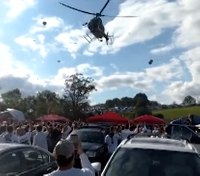 Video: FAA investigating after low-flying police chopper causes ruckus at Pa. tailgate
