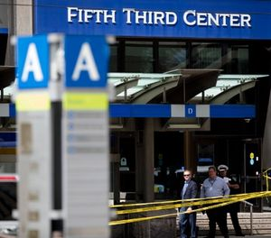 In this Sept. 6, 2018 file photo, police investigate outside Fifth Third Bank building on Fountain Square after a shooting with multiple fatalities in downtown Cincinnati. (Albert Cesare/The Cincinnati Enquirer via AP, File)