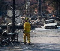 Two arrested for looting firefighting bulldozers during wildfire