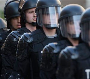 In this May 23, 2015, file photo, riot police stand in formation as a protest forms against the acquittal of Michael Brelo, a patrolman charged in the shooting deaths of two unarmed suspects in Cleveland. (AP Image)