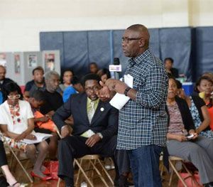 CMPD Police Chief Rodney Monroe is pictured speaking to attendees at a 'Cops and Barbers' event. (Photo courtesy CMPD)