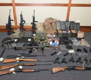 This image provided by the U.S. District Court in Maryland shows a photo of firearms and ammunition that was in the motion for detention pending trial in the case against Christopher Paul Hasson.  (U.S. District Court via AP)